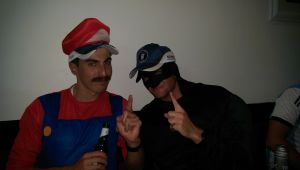 Best dressed Harry Dunn as Batman and lucky door prize winner Army as Mario