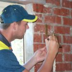 Aussie Test hero Josh Hazlewood signing the 'historic' bell of the S.S. Collaroy